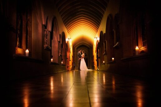wedding couple in the corridor of stanbrook abbey in worcestershire
