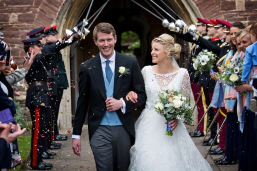 wedding couple leaving st mary church in thornbury