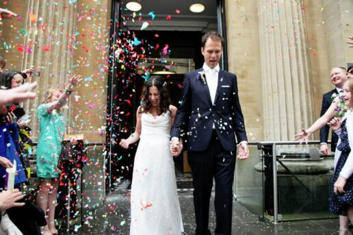 confetti and wedding couple in front of bristol register office